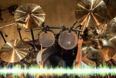 Male musician playing drum kit at studio Stock Photography