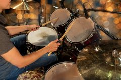 Male musician playing drum kit at concert Stock Image