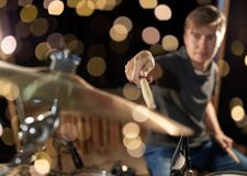 Male musician playing drum kit at concert. Music, people, musical instruments and entertainment concept - male musician playing drum kit at concert or studio Royalty Free Stock Images