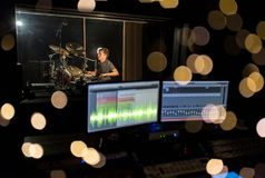 Man playing drum kit at sound recording studio Royalty Free Stock Photography
