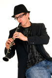Music performer, clarinet. Handsome alternative dressed music performer, clarinet player.  Studio, white background Stock Image
