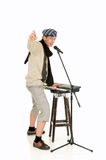 Music performer, keyboard. Handsome alternative dressed music performer, keyboard piano player. Studio, white background royalty free stock images