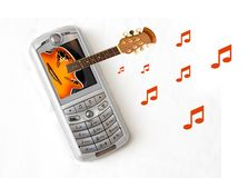 Music Phone. MP3 Music cellular phone with Guitar coming out of screen Royalty Free Stock Photography