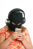 Music Piracy. Concept image of a young girl listening to pirated or illegal music downloads on her mp3 player, isolated against a white background Stock Photography