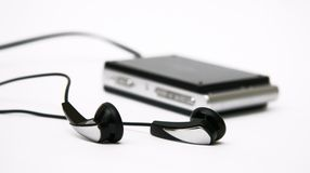 Music player with earphones. Mp3 player with earphones, isolated on white background. Video player, with big touch screen. Focusing on earphones, the mp3 player stock photos