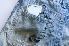 The music player in jeans pocket. Stock Image