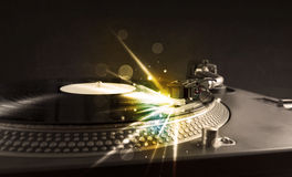 Music player playing vinyl with glow lines comming from the need Royalty Free Stock Photos