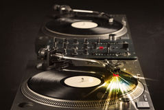 Music player playing vinyl with glow lines comming from the need Royalty Free Stock Images
