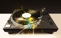 Music player playing vinyl with glow lines comming from the need Royalty Free Stock Image