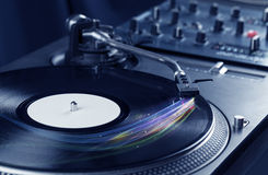 Music player playing vinyl music with colourful abstract lines Stock Image