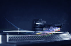 Music player playing vinyl music with colourful abstract lines Royalty Free Stock Photo