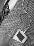 Music player in suit pocket. Portable music player in business suit pocket Royalty Free Stock Photo
