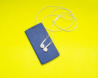 Music player on yellow background Stock Image