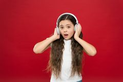 Music plays an important part lives teenagers. Powerful effect music teenagers their emotions, perception of world. Girl. Listen music headphones on red stock photography