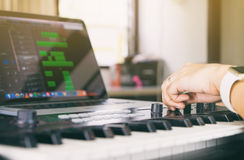 Music producer is checking sound on work station stock images