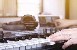 Music producer making song on keyboard royalty free stock images
