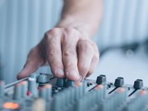 Music producer professional career man sound. Music producer professional career. Closeup of man hand adjusting sound effects. Copy space royalty free stock photo