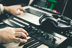 Music producer is recording sound. On Computer Stock Photo