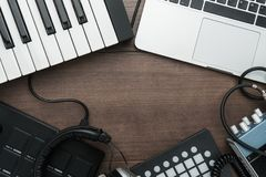 Music production equipment. Top view of home studio music production equipment with copy space stock image