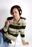 Music relax. Girl listen music in headphone and relax in think and imagine Royalty Free Stock Images