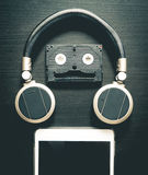 Music Robot using headphone cassette tape and tablet Stock Photography