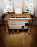 Music room with organ. An old organ in an old room with a wooden floor a blank music sheet Royalty Free Stock Photos
