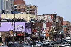 Music Row in Downtown Nashville on a Summer`s Day. Music Row in Nashville, Tennessee highlighting the honky tonks, bars,  and shopping on a sunny day with Royalty Free Stock Photo