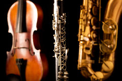 Music Sax tenor saxophone violin and clarinet in black Royalty Free Stock Photography