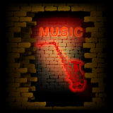 Music saxophone neon light in the brick wall uno Royalty Free Stock Images