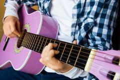 Music school of guitar for children Stock Photos