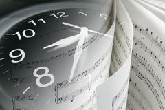 Music Score and Clock Stock Image