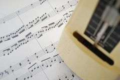 Music score and metronome Royalty Free Stock Images