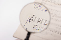 A music score. View of the notes in a music score through a magnifying lens Stock Image