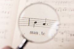 A music score. View of the notes in a music score through a magnifying lens Stock Photos