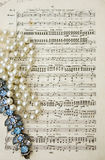 Music scores by Mendelssohn with pearls Stock Photography