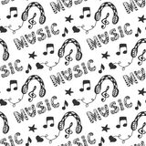 Music seamless pattern with hand drawn headphones and doodle lettering Music. Vector illustration with melody music print. Stock Photos