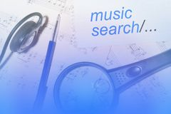 Music search.The two pieces of the score notes, magnifying glass. Ballpoint pen, headphones. Different music for everyone royalty free stock images
