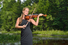 Music Series - outdoor violin or fiddle player Royalty Free Stock Photos
