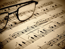 Music sheet. A closeup of a sheet of piano music and goggles Royalty Free Stock Photos