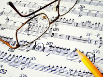 Music sheet. A closeup of a sheet of piano music with goggles and pencil Stock Photo