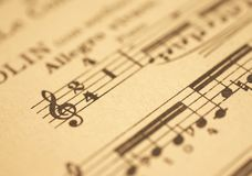 Music sheet. An old music sheet with focus on the g-clef Stock Image