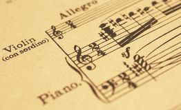 Music sheet. An old music sheet with violin and piano part Stock Images
