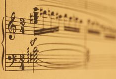 Music sheet. An old music sheet with focus on G and F clefs Stock Photography