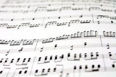 Music sheet. Black music note on white paper closeup Royalty Free Stock Photos