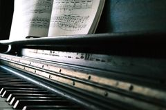 Music Sheet on Black Piano royalty free stock images