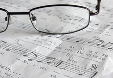 Music sheet and the glasses. Music sheel and glasses Stock Image