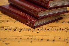 Music sheet and old books stock illustration