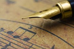Music sheet and pen. Close up of Music sheet and pen Royalty Free Stock Image