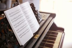 Music sheets on piano. Close up Stock Photo