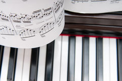 Music sheets and piano. Instrument in the background Stock Photography